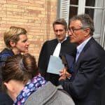 Guy Novès à la sortie du Conseil des Prud'Hommes en compagnie de son avocat Me Nougarolis. Crédit : Enzo Contreras