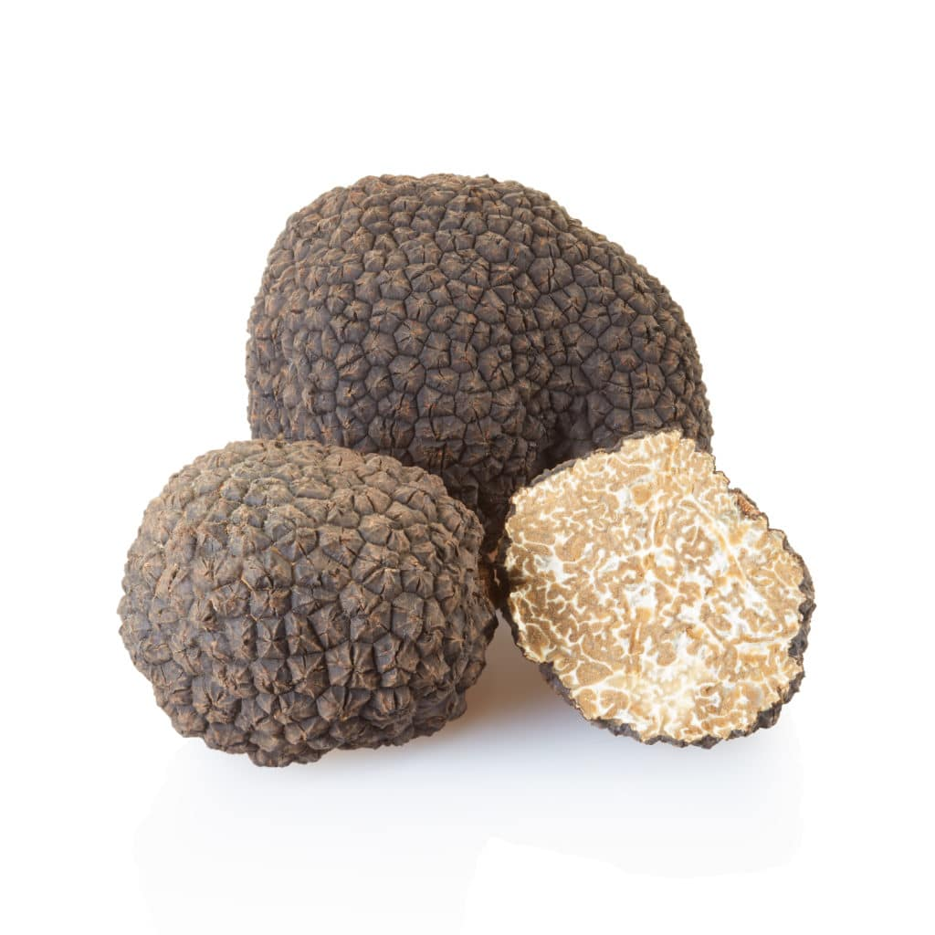 black-truffles-and-half-on-white